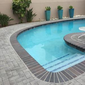 pool with nice pavers all around