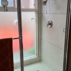 super original and mostly cool master shower. love the terrazzo, wouldn't mind replacing the glass and the shower head.