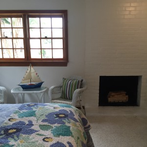 downstairs bedroom with fireplace