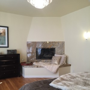 the master suite is on the first floor at the front of the house and has a lovely fireplace.