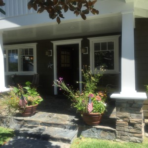 welcoming front porch - i love square columns and quality stonework!