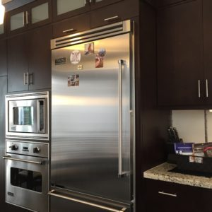 rich espresso cabinets pair nicely with the stainless steel appliances