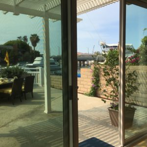 view from the living room, through the screen door, out to the waterfront patio. this place could be so spectacular!