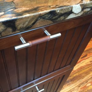 leather-wrapped cabinet pulls!