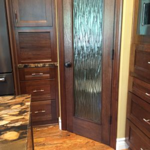 appliance garage in the cabinetry. pantry with custom glass door