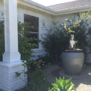 water feature in the front yard. makes a nice focal spot for the front bedroom as well.