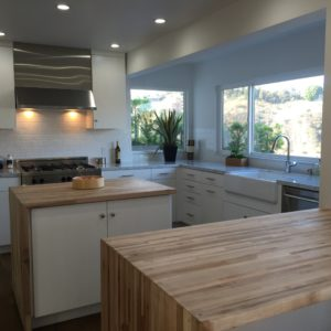 "interesting butcher block ""waterfall"" on just one side of the island"